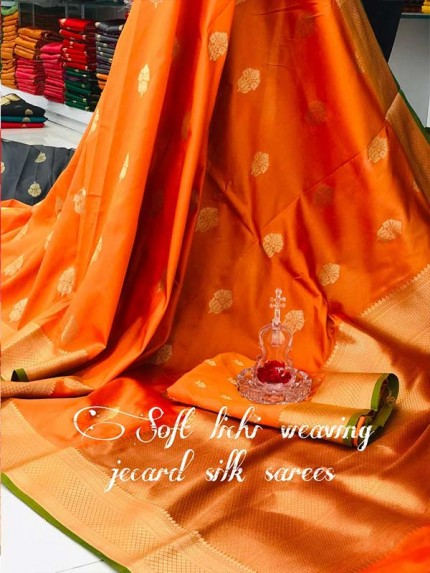Graceful combination Orange Color Lichi Silk weaving Jacquard Saree